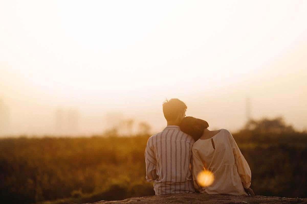 man-and-woman-near-grass-field-1415131